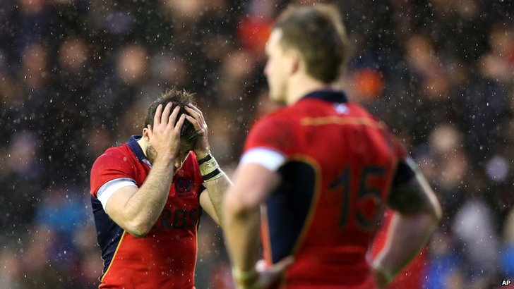 "Scotland""s Tommy Seymour, left, stands dejected after the defeat by Italy"