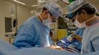 Surgeons performing heart operation (posed)