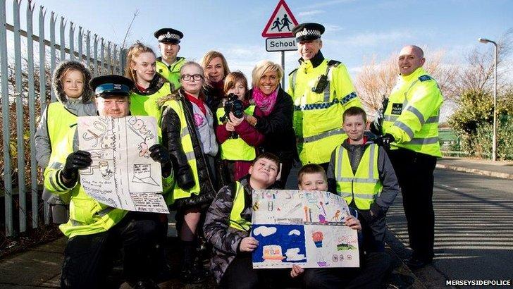 Police, teacher and kids outside school