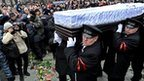 The coffin of Boris Nemtsov is carried from a memorial service in Moscow