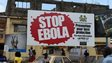 People walking past a billboard with a message about ebola in Freetown. Sierra Leone