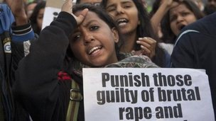 Protesters shout slogans against the gang rape and murder of a 30-year-old woman in New Delhi, India, Sunday, Jan. 11, 2015.