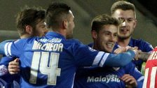 Cardiff players celebrate at Rotherham