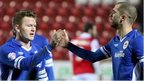 Aron Gunnarsson and Matt Connolly celebrate