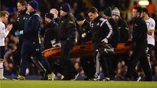 Bafetimbi Gomis on a stretcher
