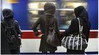 Women standing on platform of Tehran metro