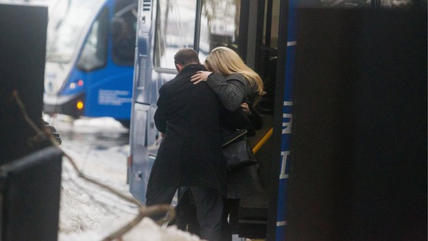 Boston Marathon bombing survivor Heather Abbott is helped from a bus outside of Joseph Moakley United States Courthouse during the first day of the Dzhokhar Tsarnaev trial