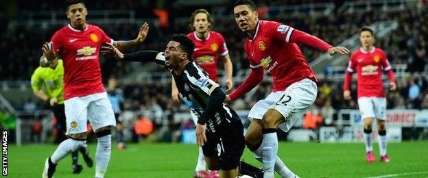 Emmanuel Riviere goes down under Chris Smalling's challenge
