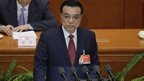 Chinese Premier Li Keqiang delivers the government work report during the opening of the annual full session of the National People's Congress at the Great Hall of the People in Beijing on 5 March 2015