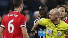 Referee Anthony Taylor holds Jonny Evans and Papiss Cisse apart