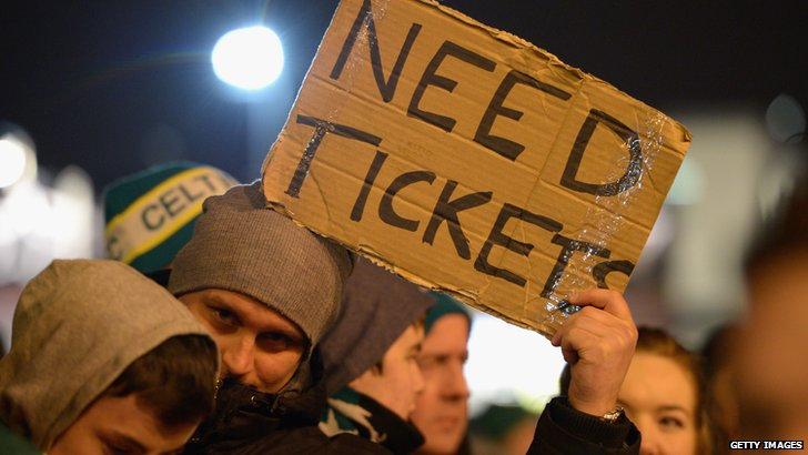 Celtic fan with sign