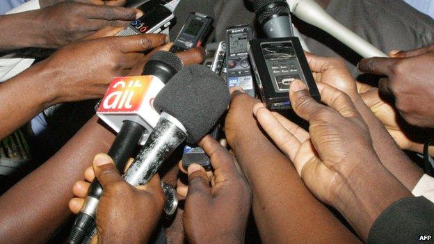 Journalists interviewing someone in Nigeria -  2012