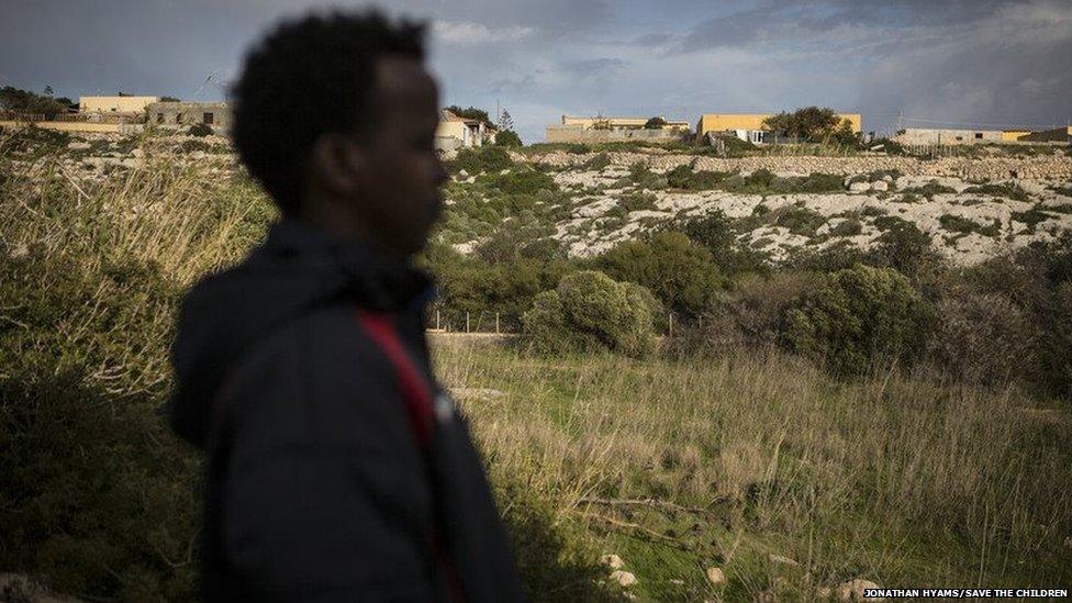 A teenage migrant boy on the Italian island of Lampedusa