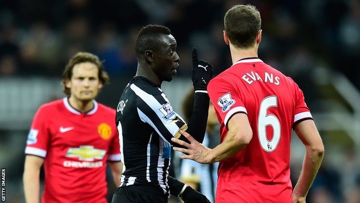 Papiss Cisse remonstrates with Jonny Evans