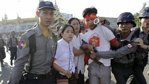 Protesters are detained by police after a gathering opposing a new education law in Yangon