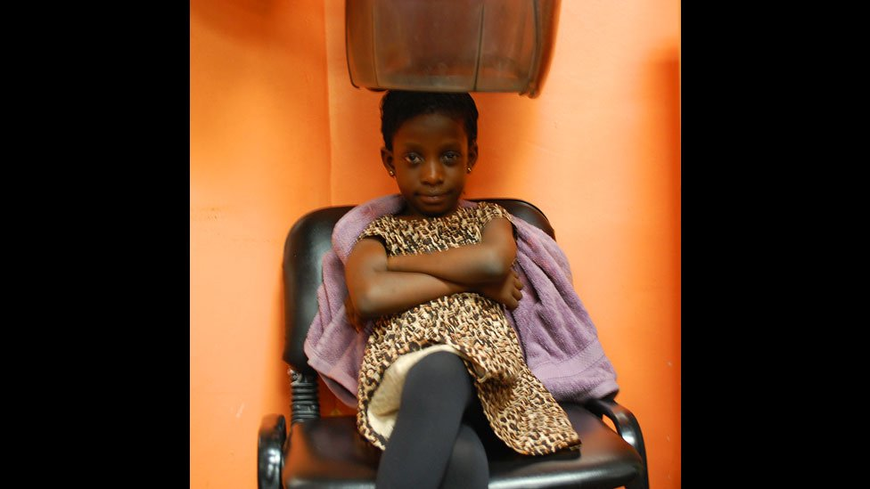 A child having her hair done at Bruno's Place hair salon in Ikeja Mall in Lagos, Nigeria
