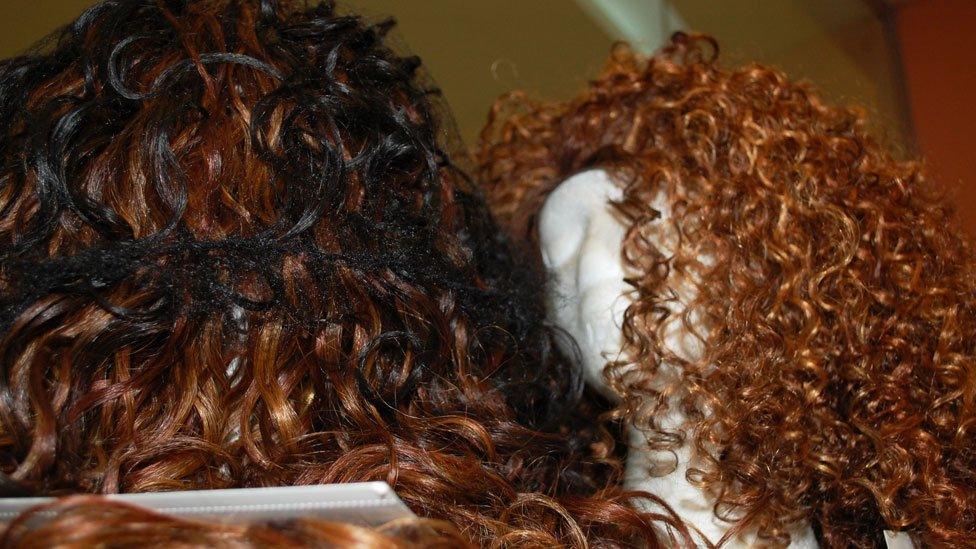 Wigs on display at Bruno's Place hair salon in Ikeja Mall in Lagos, Nigeria