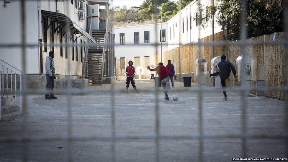 Child migrants play football on Lampedusa