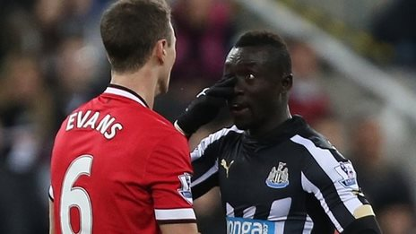 Jonny Evans and Papiss Cisse