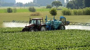 A farmer spreads pesticides on a field in Vimy near Lens, France on 24 June 24 2014