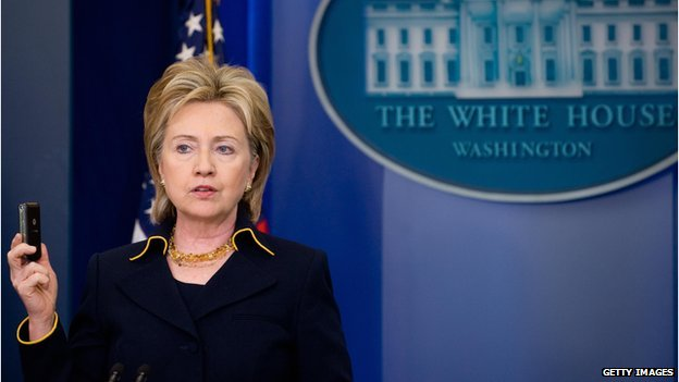 US Secretary of State Hillary Clinton holds up a cell phone as she announces release of 100 million dollars in emergency aid to help displaced civilians in Pakistan in the Brady Briefing Room of the White House in Washington, DC, 19 May 2009.