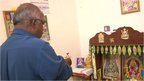The father of one of the passengers on board MH370 praying to the Hindu gods