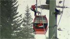 A rescue worker on top of a cable car