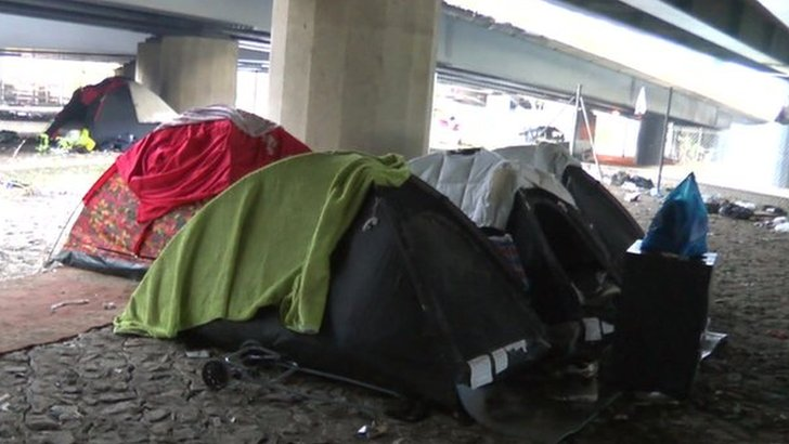 Tents pitched under a London motorway