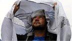 Man puts on burka