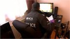 A police officer on a cybercrime raid
