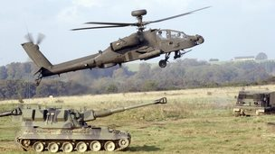 A UK Apache attack helicopter taking part in a training exercise on Salisbury Plain