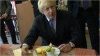 Boris Johnson eats a parmo