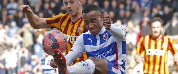 Reading defender Jordan Obita clears under the watch of Bradford striker Jon Stead