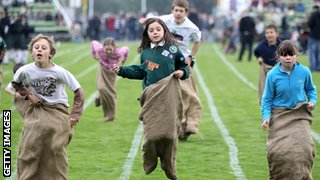 young kids participating in a sack race