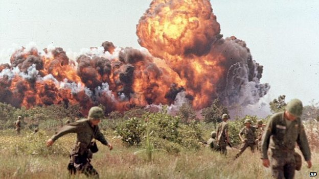 American soldiers run from a napalm attack during the Vietnam War