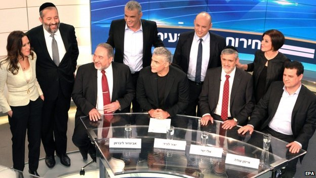 "Israeli political party leaders with the an Israeli Channel 2 host (L) posing for a group portrait prior to the taping of the ""political duel"" or election television debate in the Neve Ilan TV studio"
