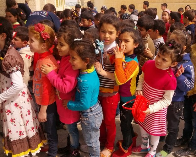 Syrian refugee children queue