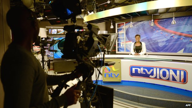 Kenya's Nation TV anchor Jane Ngoiri works on 11 March 2015 in Nairobi