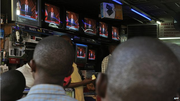 People watch on television sets in a shop in Nairobi Uhuru Kenyatta's speech after he was declared winner of a presidential election in Kenya - March 2013