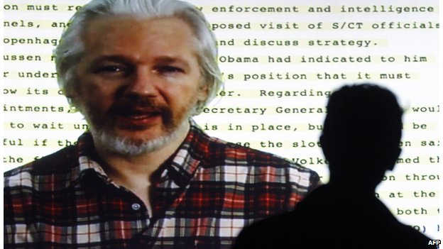 Julian Assange on a video link to a human rights conference in Barcelona