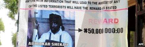 Wanted poster for Boko Haram leader Abubakar Shekau in Maiduguri, Nigeria - May 2013