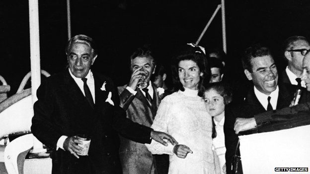 Jacqueline Kennedy Onassis with her daughter, Caroline Kennedy, and her new husband, Greek shipping magnate Aristotle Onassis  after their wedding
