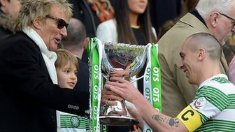 Scott Brown receives the trophy from Rod Stewart