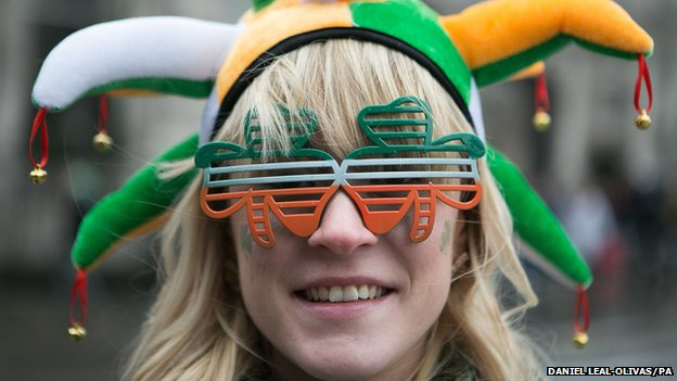 A woman enjoys the day at the Mayor of London's St Patrick's Day Parade and Festival in London