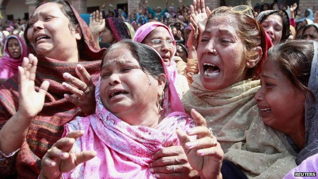 Women from the Christian community mourn for their relatives, who were killed by a suicide attack on a church, during their funeral in Lahore, March 17, 2015