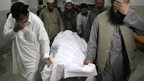 Relatives move the body of Samiullah Afridi body in hospital