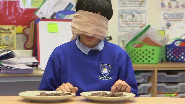 Child taking chocolate taste test