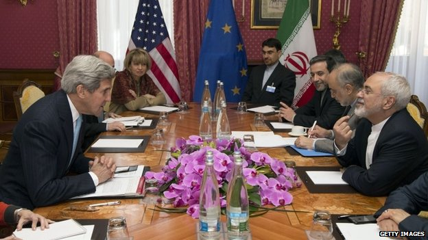 """US Secretary of State John Kerry (L) meets with Iran""""s Foreign Minister Mohammad Javad Zarif (R) on March 18, 2015 over Iran""""s nuclear program in Lausanne."""