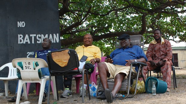 Cricket spectators - including former Nigerian internationals - watching a game of cricket in Lagos, Nigeria