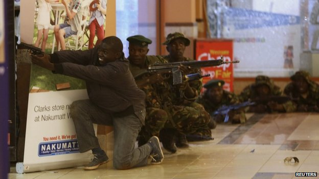 Soldiers and armed police hunt gunmen who went on a shooting spree in Westgate shopping centre in Nairobi 21 September 2013.